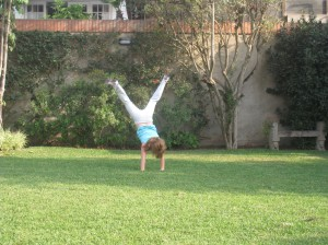 Youngest child doing a cartwheel