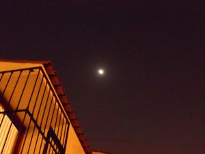 Shot of moon and house