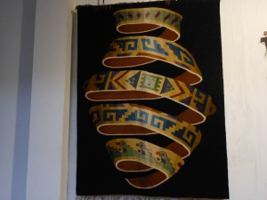 Photo of rug on exhibit in Museo Inka in Cusco, Peru