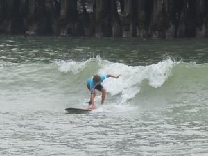Child surfing in Pacific Ocean
