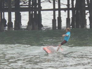 Child surfing in Lima, Peru