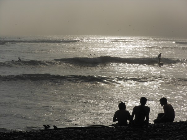 Sunset and surfers in Lima, Peru