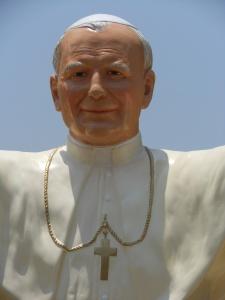 Closeup of status of Pope John Paul II in suburb of Lima, Peru