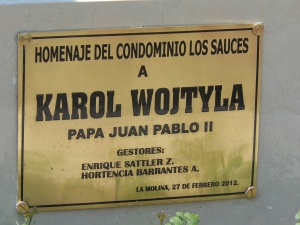 Plaque at base of status of Pope John Paul II