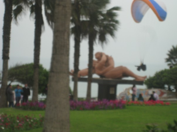Statue and paraglider in Miraflores, Peru