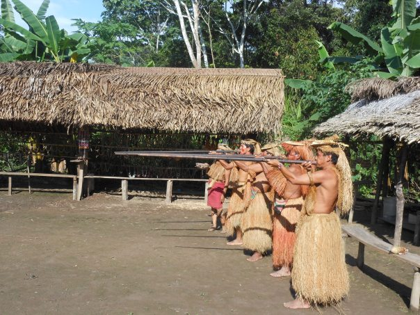 Yagua tribesmen with blow darts