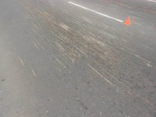 Cuts and ruts in road asphalt