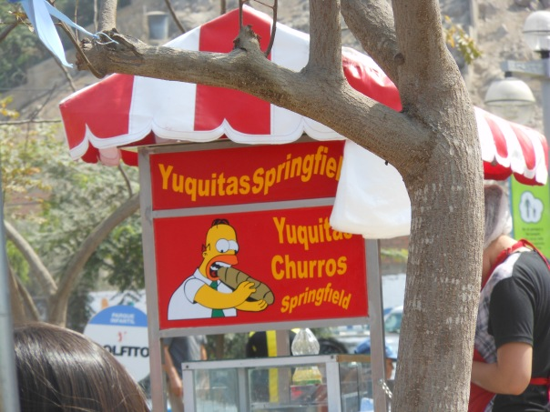 Cart selling churros and yuquitas in Peru