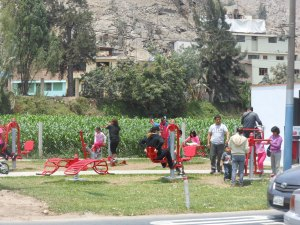 People on exercise equipment in Peru