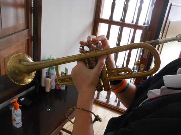 Son with trumpet