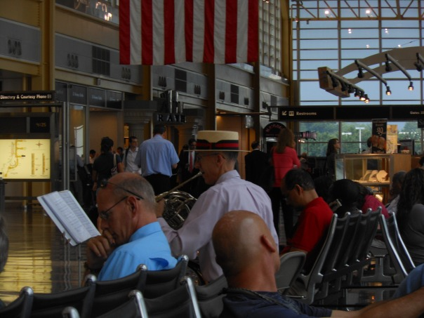 Man at Reagan Airport with French horn