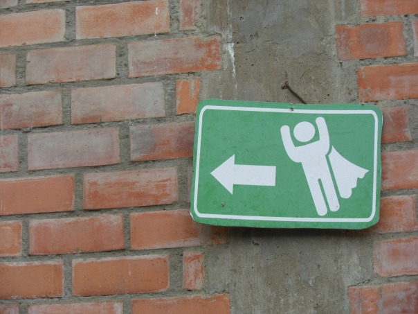If he can fly, shouldn't the arrow be pointing up?